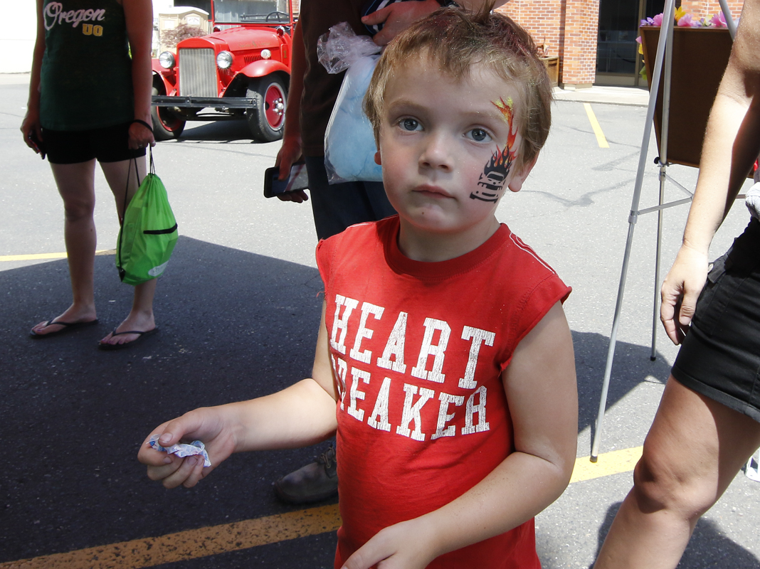 Payton Morris age 5 from Eugene, Oregon shows off his new face tattoo he got at the Show & Shine in Junction City, Oregon, June 4, 2016.
