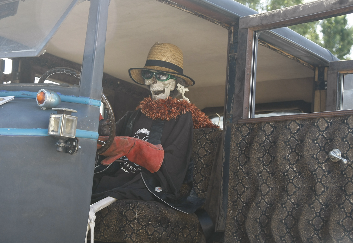 """a 1927 Hudson 4 Door """"rat rod"""" owned by Theresa and Sandy Segersons of Otis, Oregon was equipped with a skelton driver as one of the props. The car appeared at the Function 4 Junction, in Junction City, Oregon, June 4, 2016."""